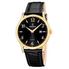 Montre avec son bracelet en cuir noir, et son cadran intérieur noir, extérieur couleur dorée.